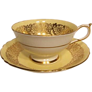 Early PARAGON Yellow with Rich Gilt Overlay Tea Cup and Saucer