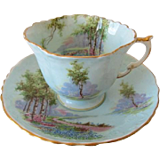 Early AYNSLEY Blue Embossed Scenic Tea Cup and Saucer