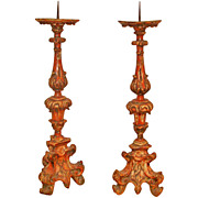 A Pair Of Italian Polychrome Prickets Or Candlesticks