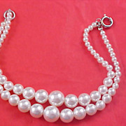 SALE CHARMING - Two Strand Simulated  Graduated Pearl Bracelet
