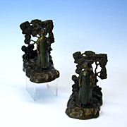 Charming pair of figural Austrian bronze bookends-girl with doll