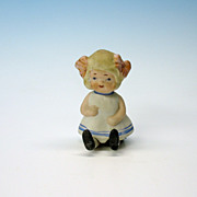 Unusual 1920's all bisque doll that sits!