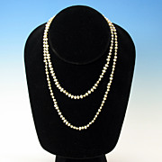 "Vintage 33"" long strand natural shape cultured pearls with silver clasp"