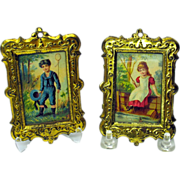 Pair large scale gilt metal framed doll house pictures