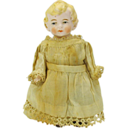 """5"""" Antique blond jointed all bisque doll in white work outfit"""