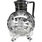 Finest 19th Century masterfully engraved glass footed pitcher with Lion masks