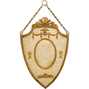 Grand Tour French ormolu and silk hanging wall portrait frame in shield shape