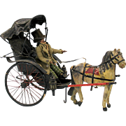 Early Man doll in beaver top hat riding in horse drawn carriage toy