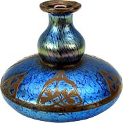 Blue Loetz glass vase with copper overlay design with 3 leaf clover