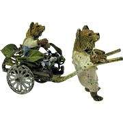 Cold painted Vienna bronze dressed Bear pulling baby bear in flower cart