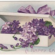 "Artist Signed Clapsaddle ""A Happy Easter"" Box of Violets Vintage Postcard"