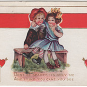 Boy on a Bench with a Girl on His Lap Valentine Vintage Postcard