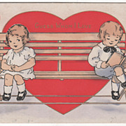 Boy and Girl Sitting at Each End of a Wooden Bench Valentine Vintage Postcard