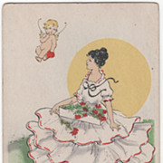 SOLD Young Woman with Box of Flowers and Cupid Flying Overhead Valentine Vintage Postcard