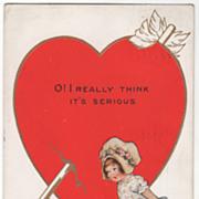 Little Girl Looking at Large Arrow-Pierced Heart Valentine Vintage Postcard
