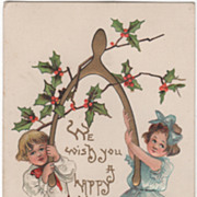 Artist Signed H B Griggs Boy and Girl Holding a Wishbone Vintage New Year Postcard