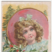 """Girl in a Circular Frame with Holly around It """"Greetings"""" Vintage Greetings Postcard"""