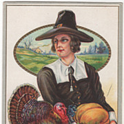 Pilgrim Man with Grapes and a Pumpkin Turkey Gobbler on a Fence Vintage Thanksgiving Postcard
