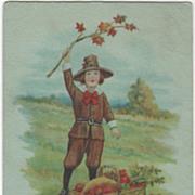 Pilgrim Boy Waving a Tree Limb Basket of Harvest Bounty Vintage Thanksgiving Postcard