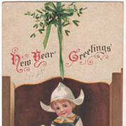 Signed Clapsaddle Little Dutch Girl under Mistletoe Vintage New Year Postcard