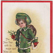 Signed Clapsaddle Child in Green Carrying Snowshoes Vintage New Year Postcard