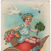 SOLD Child Sitting on Heart Flower Basket Clover Bouquet Vintage Valentine Postcard - Red Tag