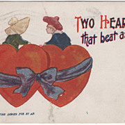 Sunbonnet Girl and Boy Sitting on Two Red Hearts Vintage Valentine Postcard