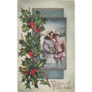 Girl with a Clover and a Boy with a Sack Holly Vintage Christmas Postcard