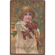 Little Girl with Toys in Front of Christmas Tree Vintage Christmas Postcard