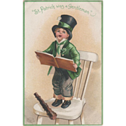 Unsigned Clapsaddle Boy in Green Singing Chair Vintage St Patrick's Day Postcard