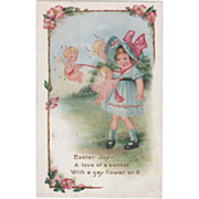 SOLD Whitney Three Cupids Tying on a Little Girl's Hat Vintage Easter Postcard - Red Tag Sale