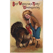 Young Boy with a Very Large Turkey Gobbler Vintage Thanksgiving Postcard