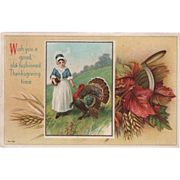 Pilgrim Woman in Meadow with Large Turkey Gobbler Vintage Thanksgiving Postcard