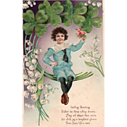 Young Boy Seated on Four Leaf Clovers Vintage Valentine Postcard