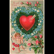 SOLD Cupid Blue Flowers Wreathing Arrow Pierced Red Heart Vintage Valentine Postcard