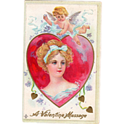 Young Woman in Red and Gold Heart with Cupid Above Vintage Valentine Postcard