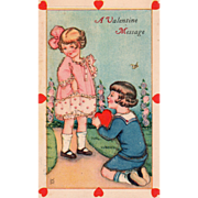 Boy Kneeling to Girl to Give Her a Red Heart Vintage Valentine Postcard