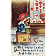 SOLD Whitney Boy and Girl with Suitcase Passing Store Window Vintage Valentine Card
