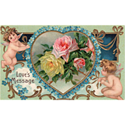 SOLD Two Cupids Heart of Blue Flowers Yellow Pink Roses Vintage Valentine Postcard
