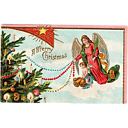 Angel In Pink Small Angel Trimming a Christmas Tree Vintage Christmas Postcard