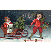 SOLD Boy in Red Pulling Girl with a White Muff on a Sled Vintage Christmas Postcard