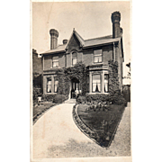 SOLD RPPC Brick Home With Couple Standing in Front Unknown Place Vintage Postcard