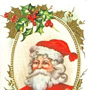 Christmas Postcard Santa Framed in Gold Oval and Holly