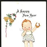 New Year Postcard Child with Bib and Horseshoe