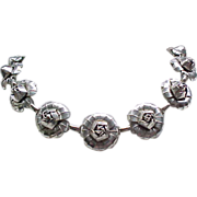 10 - Silvertone Metal Rose Necklace - 14 Roses