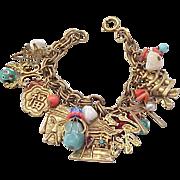 Napier Oriental Themed Charm Bracelet - Many Elements
