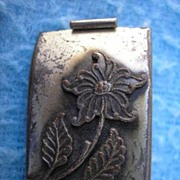 Silver plate pocket dime coin bank or safe.  Screw back pin coin locket.
