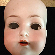 "Trebor Jointed 22"" German Doll with Porcelain Face."