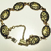 Unsigned link bracelet with cameos of flowers & birds