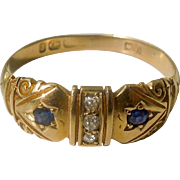 """18 carat """"Gypsy"""" band with two sapphires and three rose cut diamonds"""